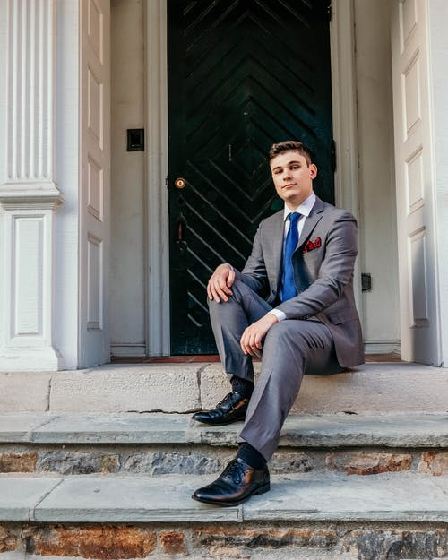 Man in Gray Suit Sitting on Gray Concrete Stairs