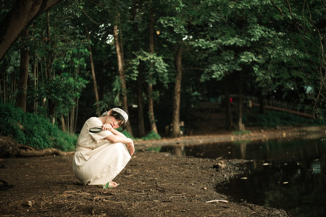 Woman in White Dress Sitting