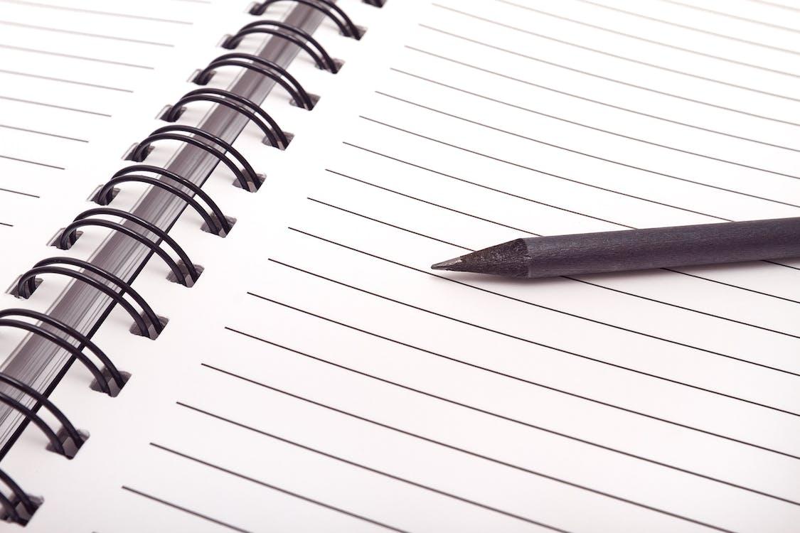 atar, caderno, caneta