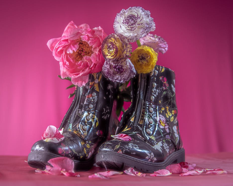 Photo of Flowers on Shoes Against Pink Background