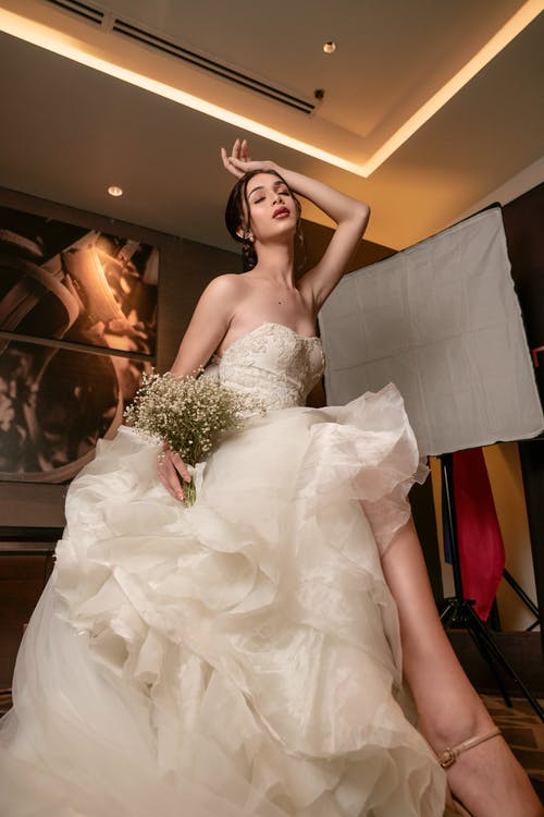 Low Angle Photo of Woman Wearing Wedding Gown