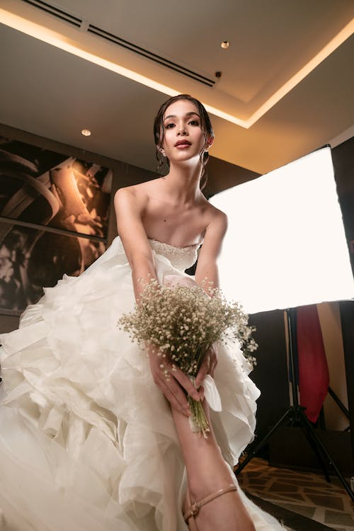 Low Angle Photo of Woman Wearing Bridal Gown
