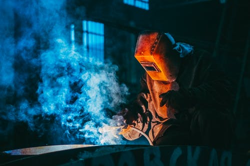 Person Welding Wearing a Prootective Metal Mask
