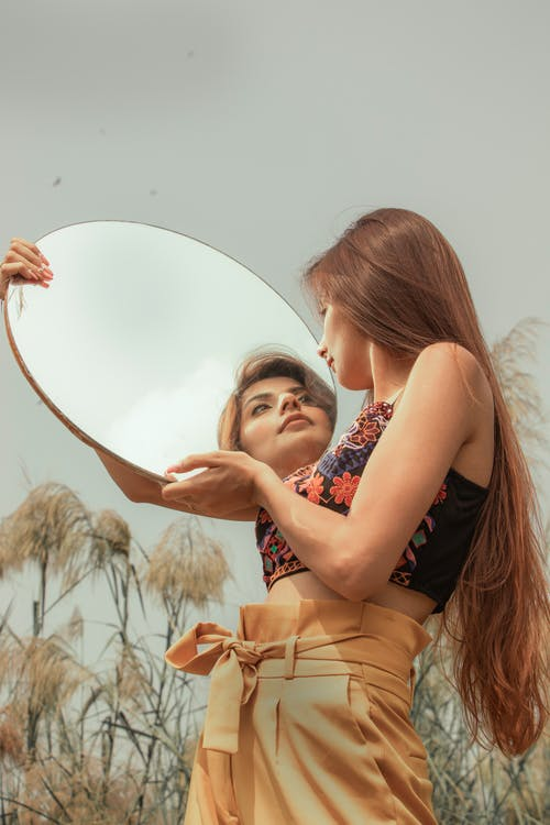 Woman Holding a Mirror