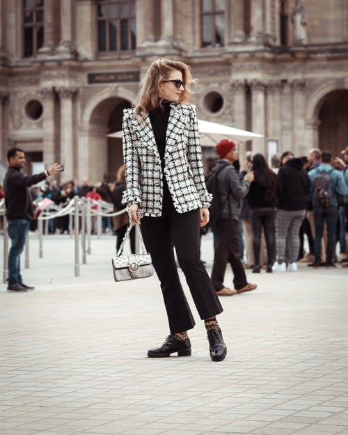 Woman Wearing Black and White Checkered Blazer Standing Pavement