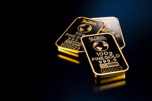 Безкоштовне стокове фото на тему «інвестиція, багатство, зливки золота, золотий»