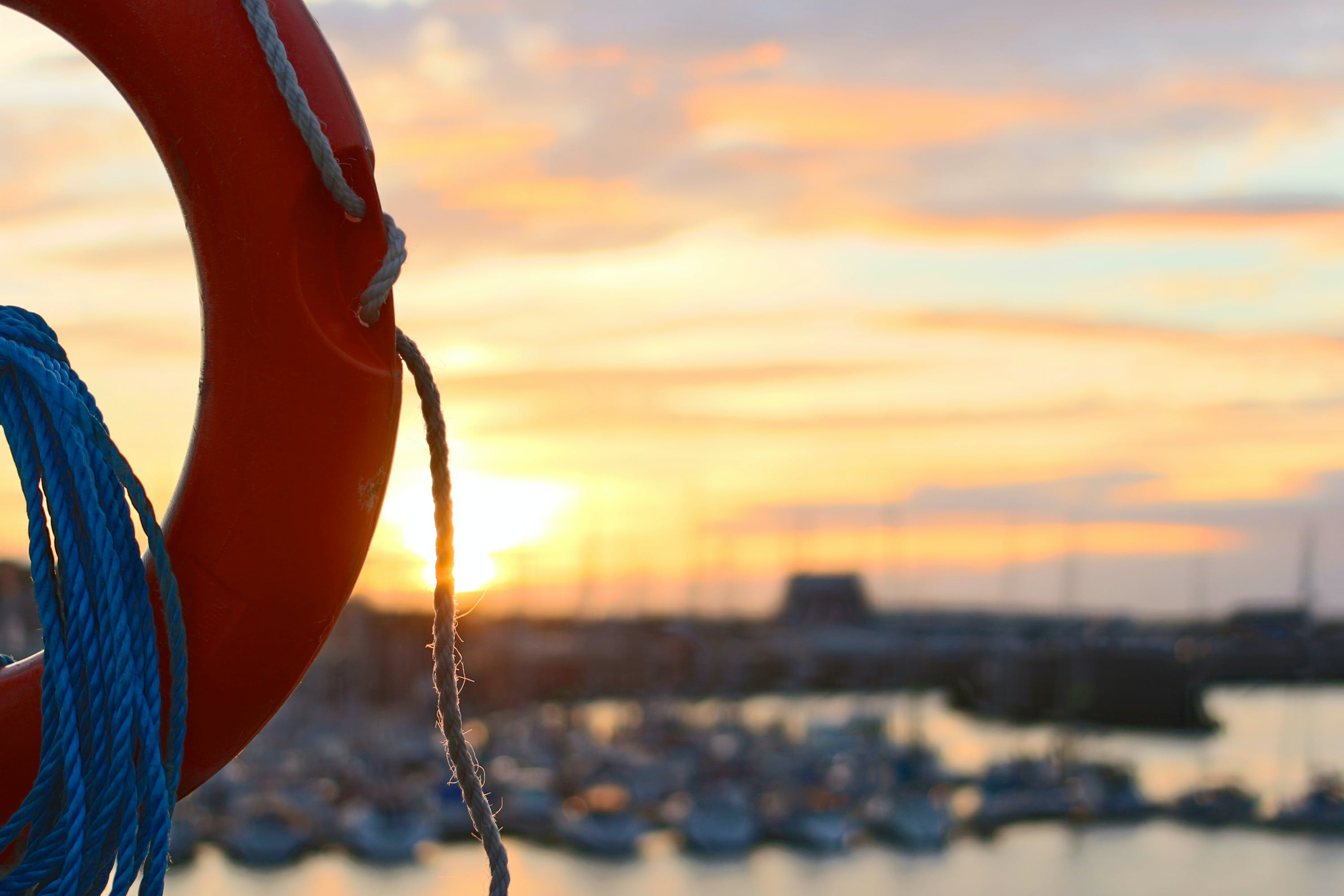 Red Life Ring With Rope during Golden Hour