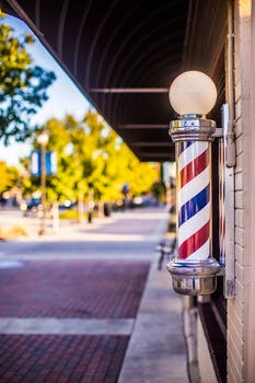 shallow focus photo of barber s pole