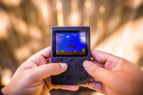 Shallow Focus Photo of Gameboy Console