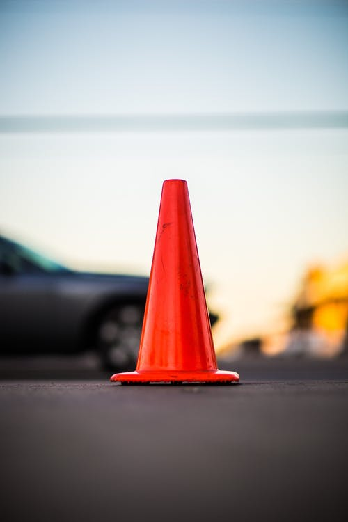 Selective Focus Photography of Orange Road Cone
