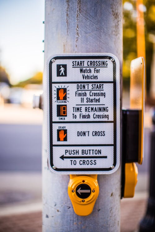 Shallow Focus Photo of Pedestrian Signage