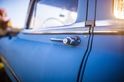 Blue Car With Chrome Door Lever