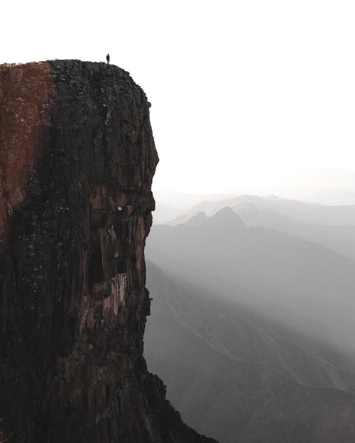 Photo Of Person Standing On Cliff