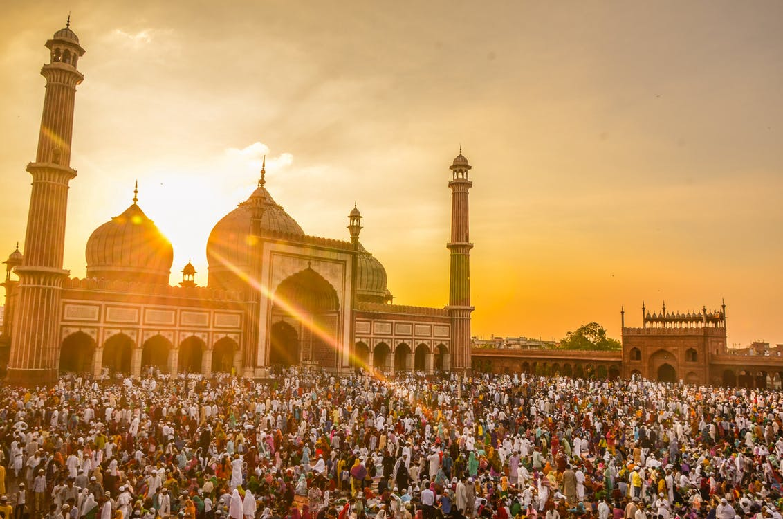 Photo Of People In Front Of Mosque During Golden Hour