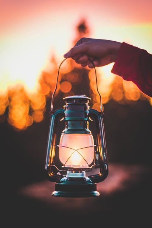 Photo Of Person Holding Lamp