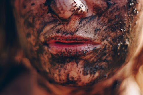 Person's Face Covered With Mud