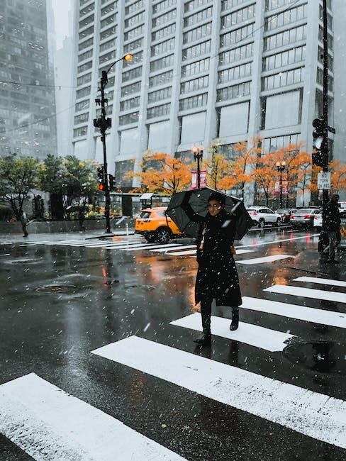 Woman holding black umbrella