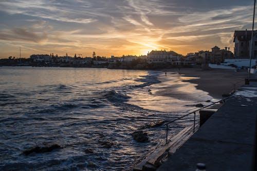 Foto profissional grátis de litoral, pôr do sol
