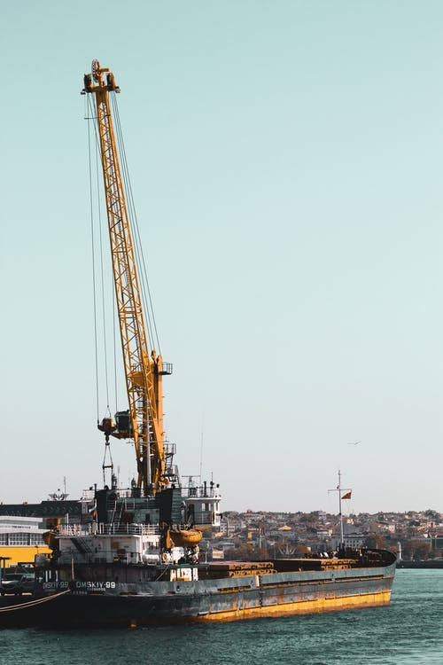 Black and Yellow Crane on Ship