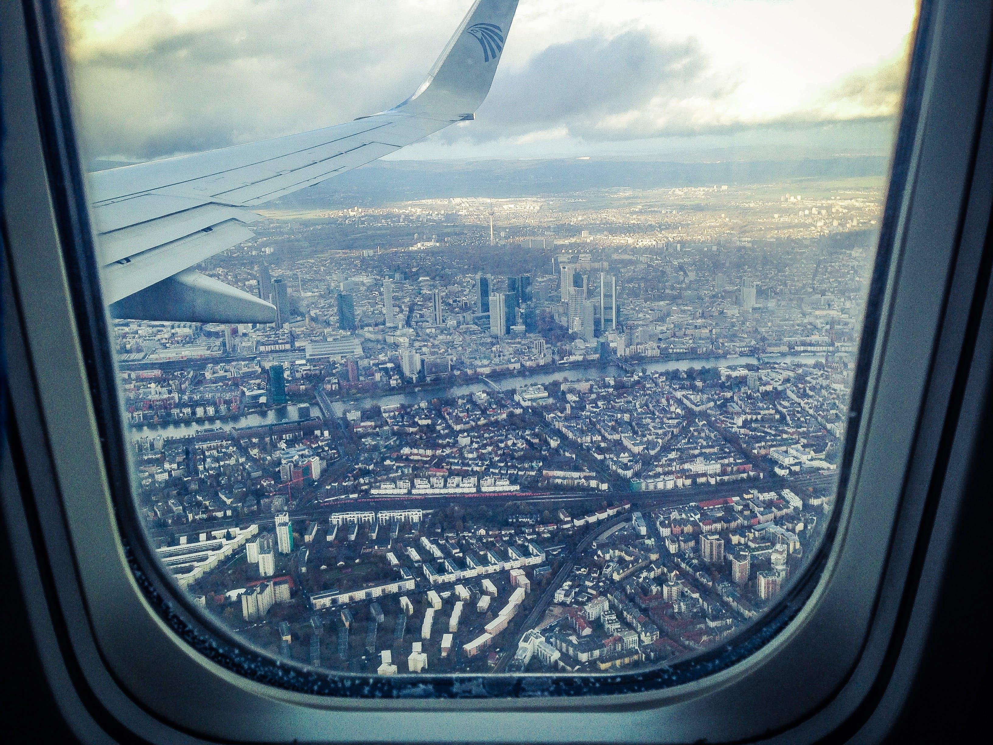 Airplane Windowpane Showing City Buildings