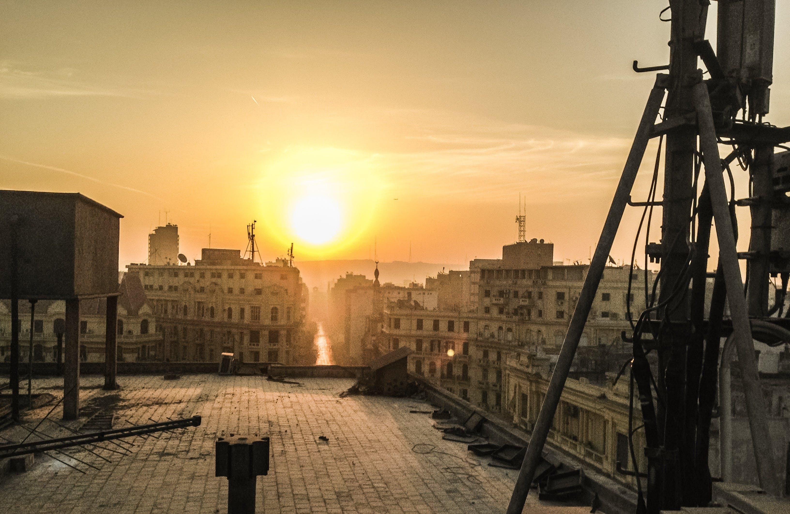 Free stock photo of buildings, sun, sunrise, capital