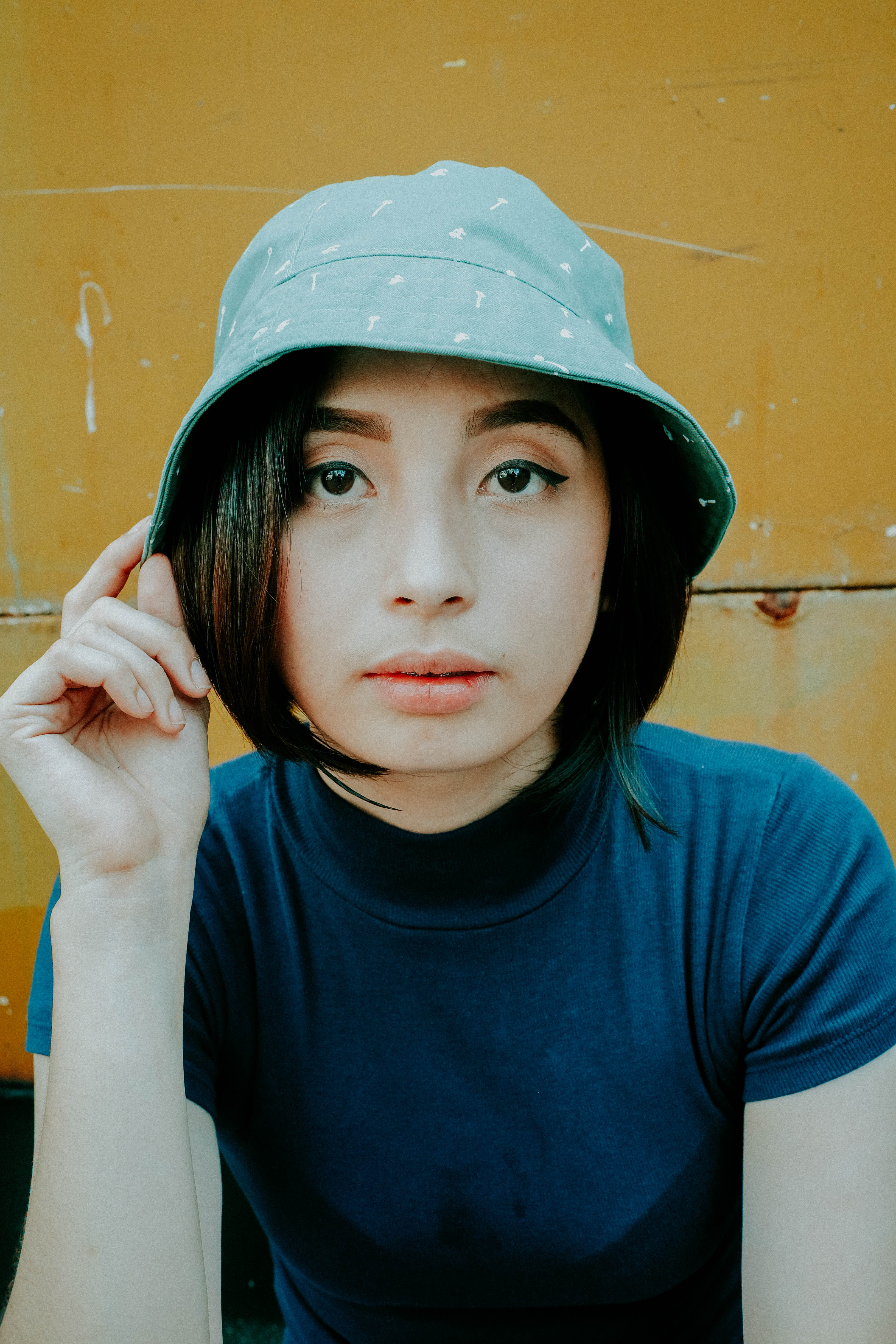 Shallow Focus Photo of Woman Wearing Gray Bucket Hat