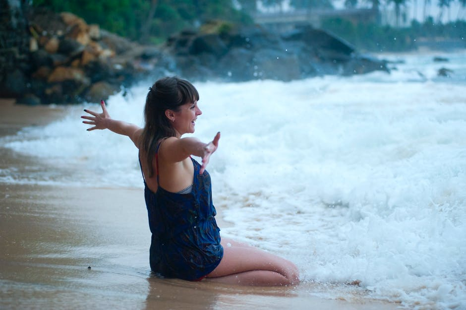 Woman Kneeling on Shoreline