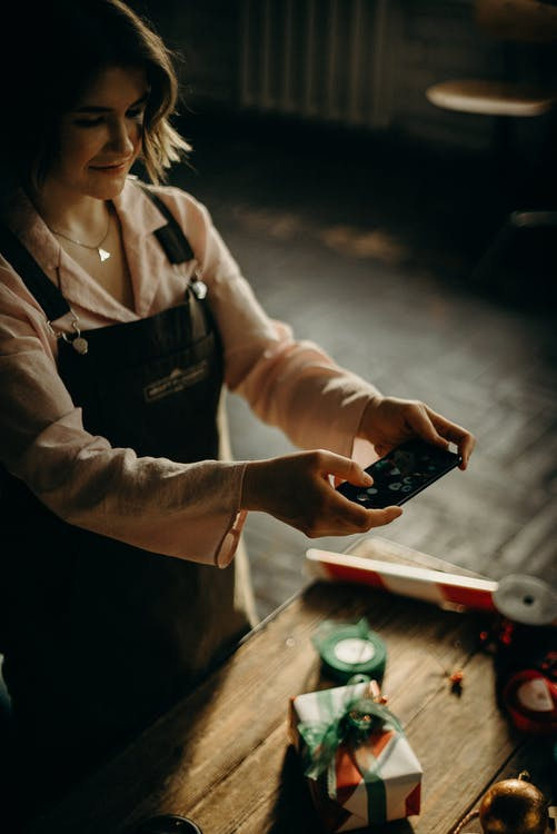 Woman Holding Black Device
