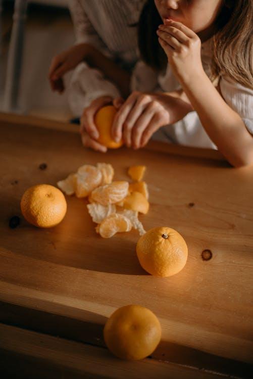 Girl Eating Orange Fruits