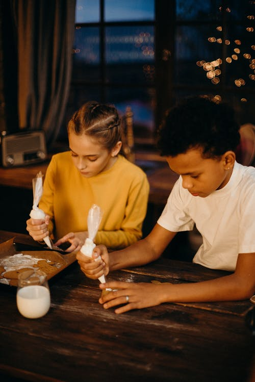 Girl and Boy Decorating Cookies