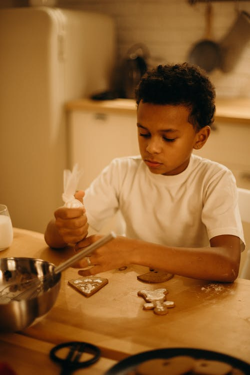 Boy Decorating Cookie