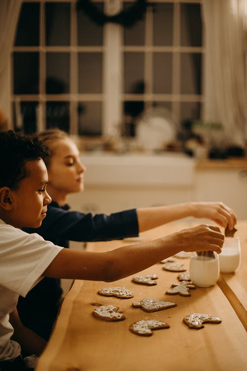 Girl and Boy Decorating Cookie