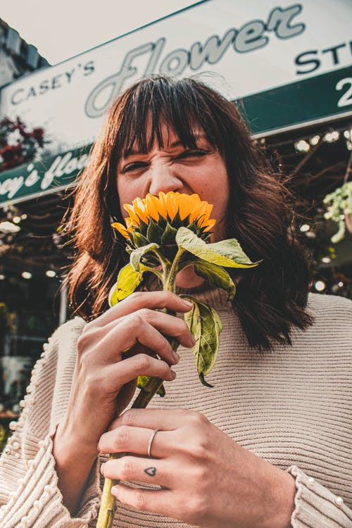 Woman Holding Sunflower