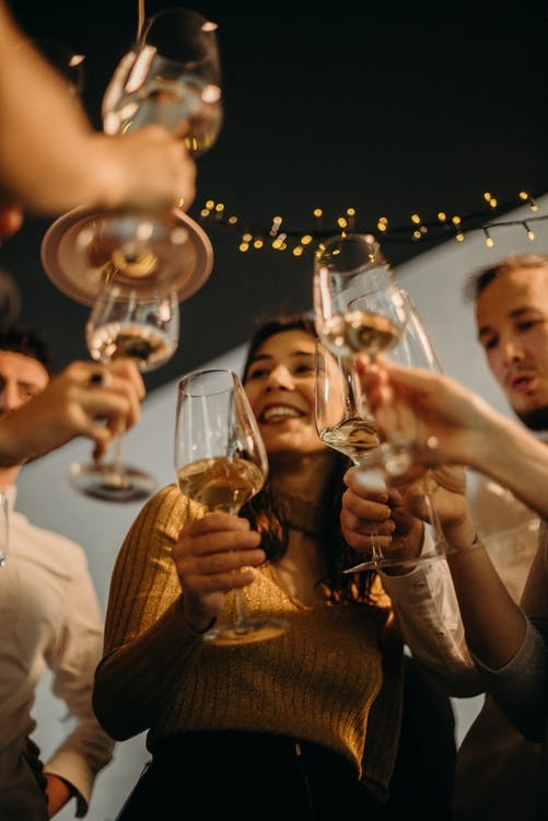 People Cheering With Wine Glasses
