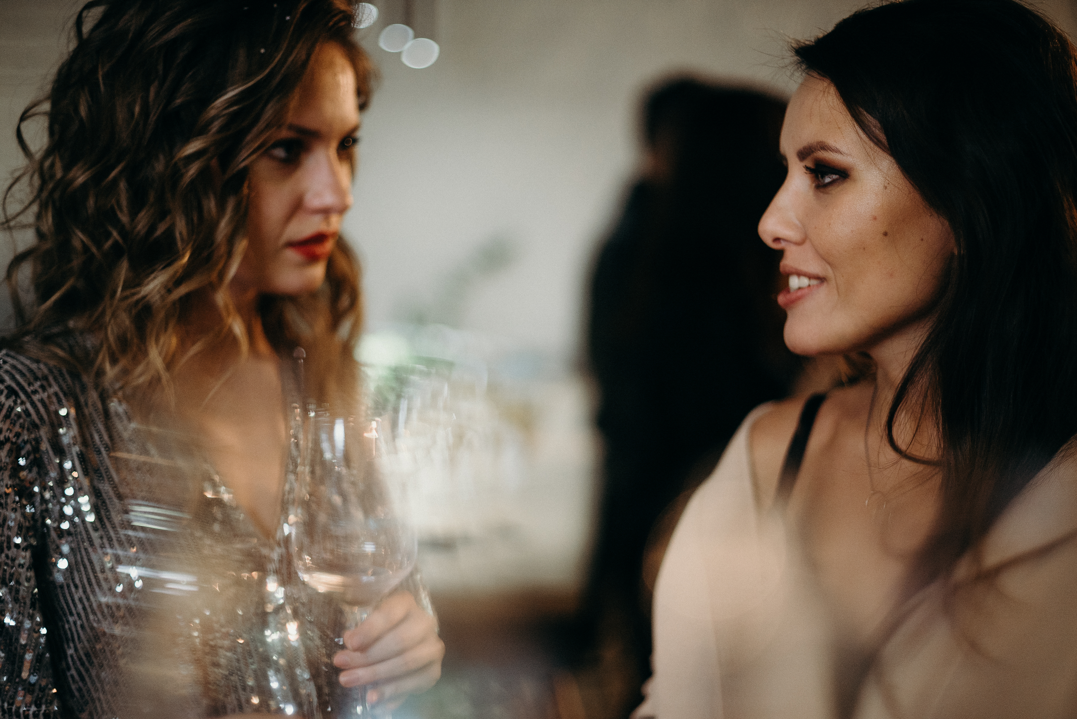 Selective Focus Photography of Two Talking Women Holding Wine Glass