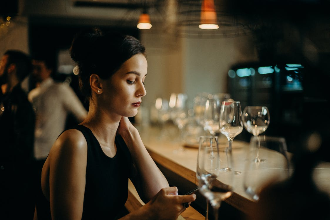 Woman Leaning on Table