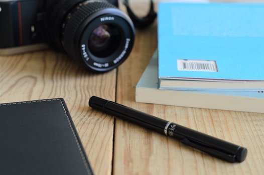Free stock photo of camera, desk, pen, table