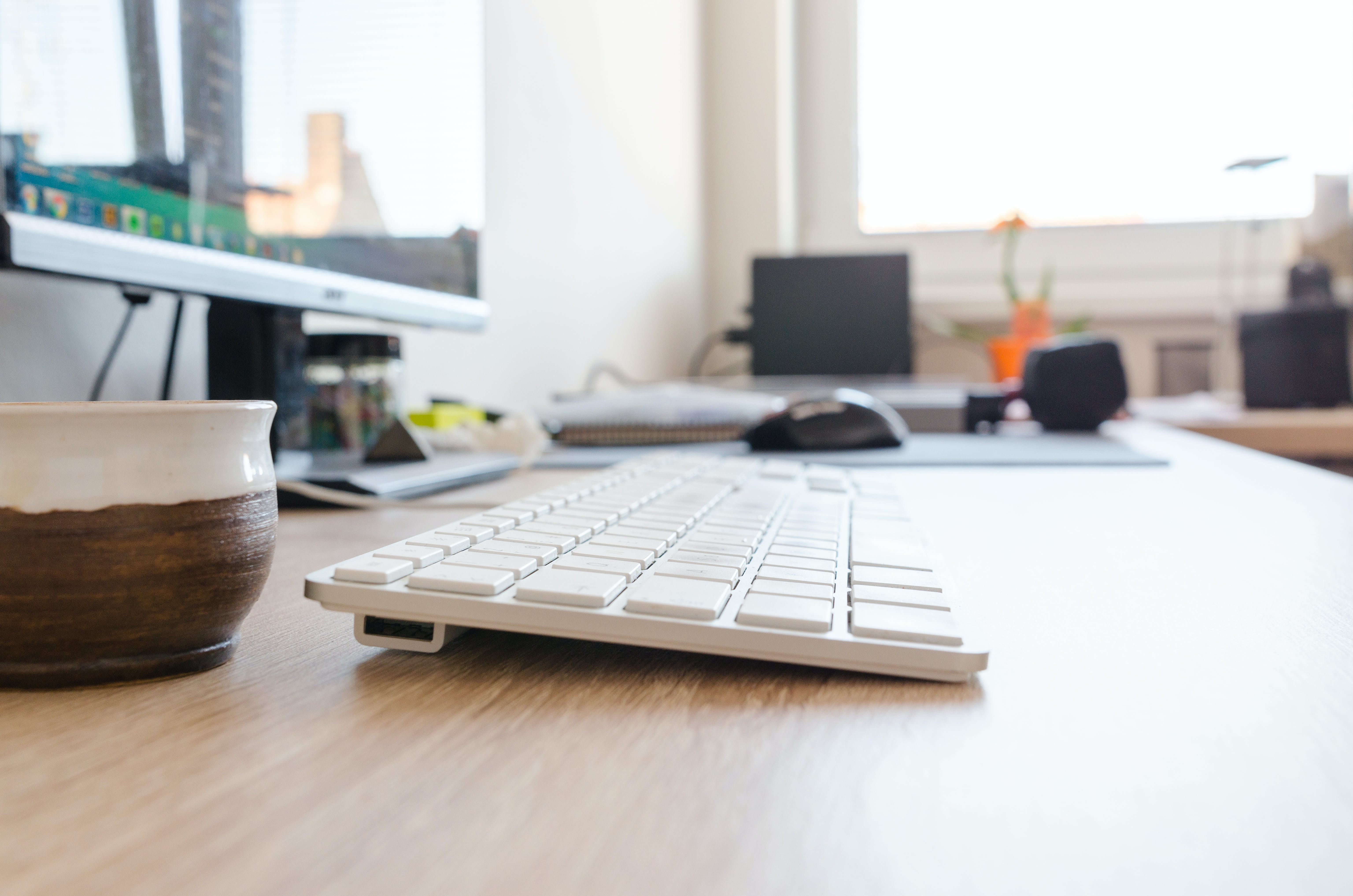 Selective Focus Photography of Wireless Keyboard on Desk
