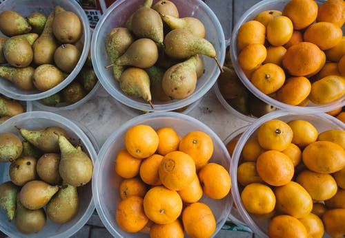 Orange Fruits on Stainless Steel Bowls