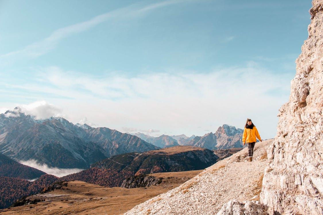 Photo Of Woman Walking Near Rock Formation