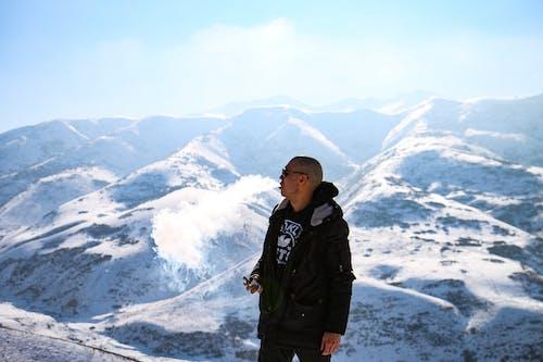 Free stock photo of blue mountains, man smoking, snow capped mountains