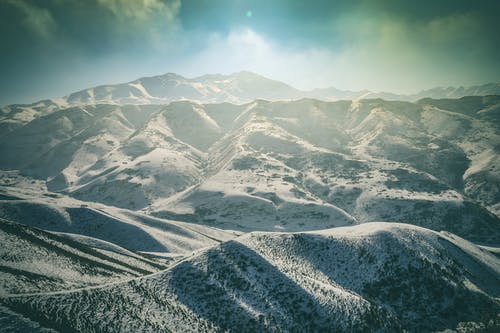 Gratis arkivbilde med ås, daggry, dal, fjell