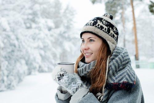Woman in Sweater Holding Mug