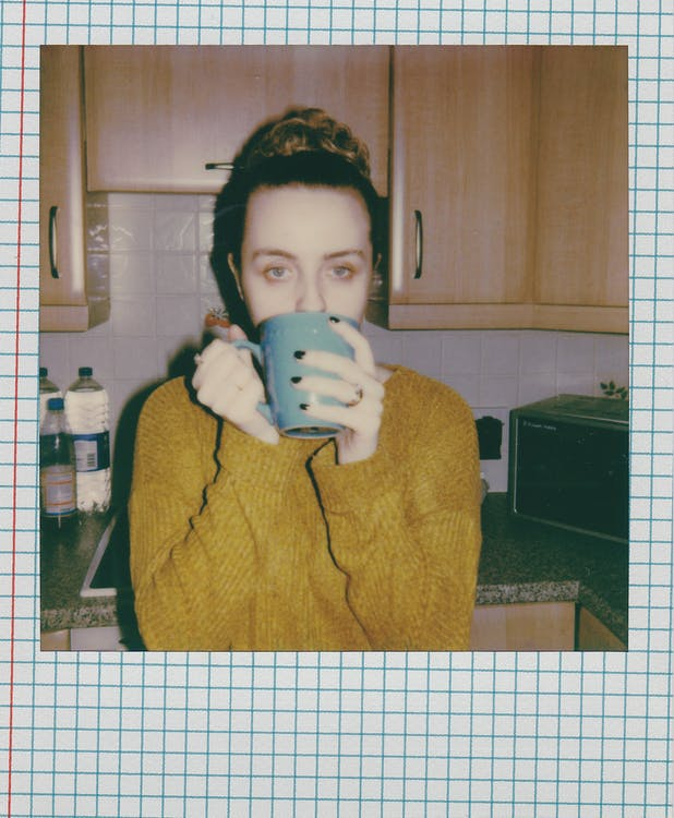 Woman Holding Ceramic Mug