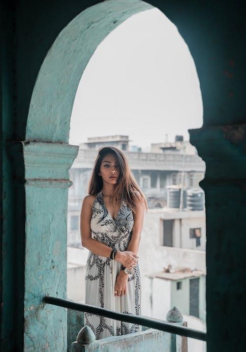 Photo Of Woman Standing On Balcony