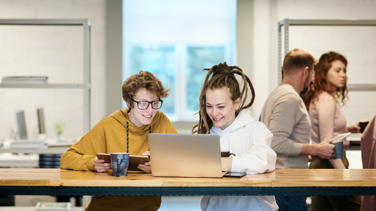 Photo Of Women Looking On Laptop