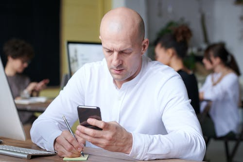 Photo Of Man Using Smartphone