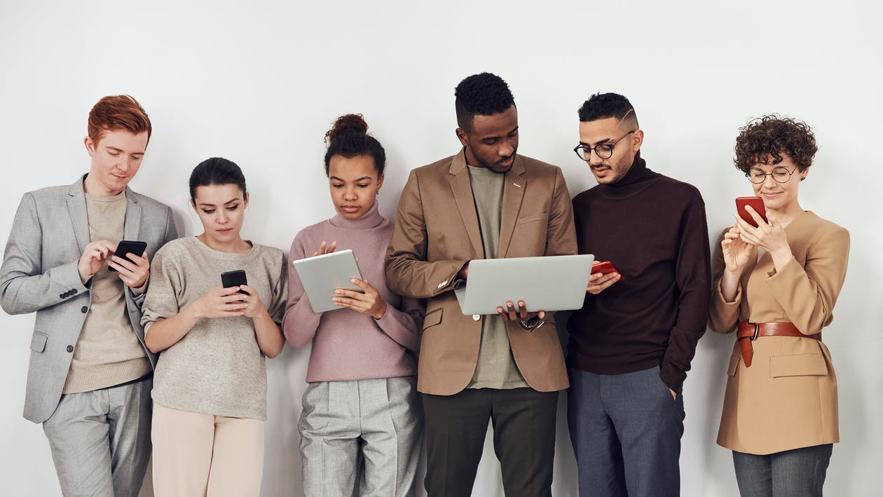 People Holding Different Devices