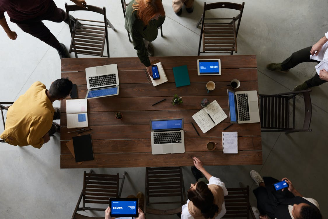 Photo Of Laptops On Top Of Wooden Table