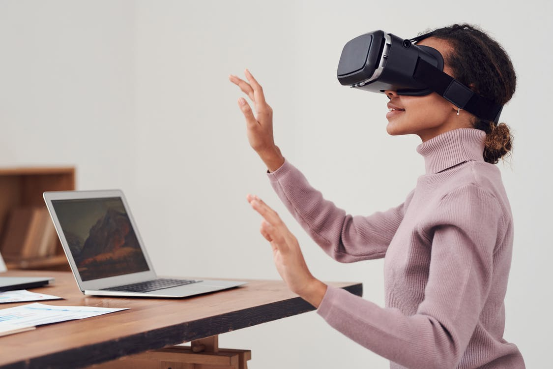 Person Using Virtual Reality Goggles